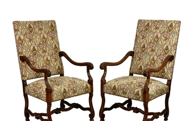A pair of 17th century style carved walnut open armchairs, V...