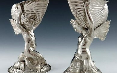A pair of Victorian silver figural salt cellars and