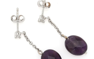 A pair of amethyst and diamond ear pendants each set with a facetted amethyst and a brilliant-cut diamond, mounted in 14k white gold. L. 2.8 cm. (2)