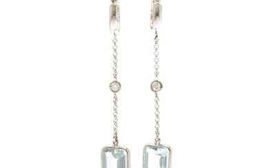 A pair of aquamarine and diamond ear pendants each set with an emerald-cut aquamarine and a brilliant-cut diamond, mounted in 18k white gold. (2)