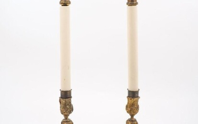 A pair of ormolu candlestick lamps, late 19th century, of...
