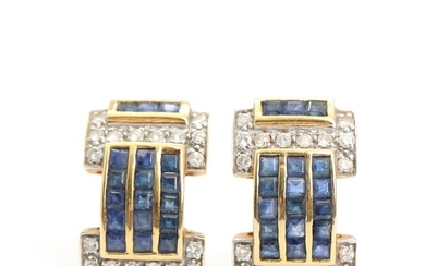 A pair of sapphire and diamond earrings set with baguette-cut sapphires and brilliant-cut diamonds, mounted in 18k gold. L. 2.2 cm. Weight app. 5.5 g. (2)