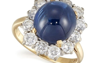 A sapphire and diamond cluster ring, the single claw-set cabochon...