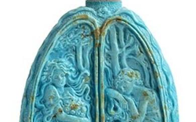 A turquoise bottle shaped sculpture with Bokè or angel skin...