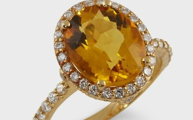 A yellow beryl, diamond, and eighteen karat gold ring