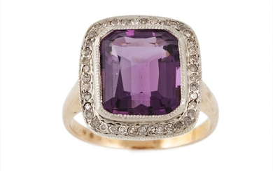 AN AMETHYST AND DIAMOND CLUSTER RING, the trap cut amethyst ...