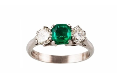 AN EMERALD AND DIAMOND THREE STONE RING, the trap cut emeral...
