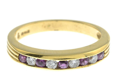 An 18ct gold ruby and diamond half eternity ring.