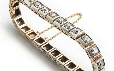 An Art Deco diamond bracelet set with numerous old-cut diamonds weighing a total of app. 5.80 ct., mounted in 14k gold and silver. Circa 1910–20.