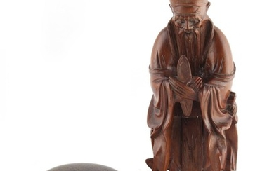 An early 20th century Chinese carved rootwood figure of an I...