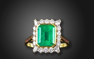 An emerald and diamond cluster ring, the emerald-cut emerald weighs approximately 4.50cts, set within a surround of round brilliant-cut and pear-shaped diamonds in gold, Sheffield marks for 1997, size V 1/2