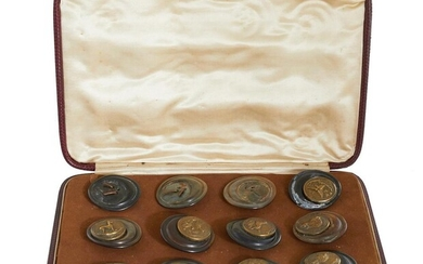 Antique cased set of sporting jacket buttons