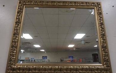 BEVELED MIRROR IN SILVER GILT FRAME