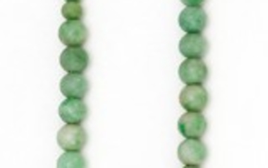 "CELADON GREEN JADE BEADED CHOKER Graduated beads with a 14kt gold clasp set with a jade disc and pearl. Choker length 16""."