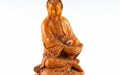 "CHINESE CARVED BOXWOOD FIGURE OF GUANYIN Seated on a rounded base. Height 5"". With wood stand."