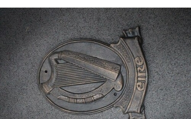 Cast Iron Oval Plaque inset with an Irish Harp over the word...