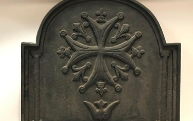 Cast iron fireback decorated with a star and fleur-de-lys.