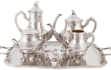 "Coffee and tea set made in punched Spanish silver with vegetable and scallop decoration. 20TH CENTURY. Approximate weight: 5.739 gr. Composed by coffee pot, teapot, sugar bowl, milk jug, strainer and tray. With the initials ""R.G"" engraved on each..."