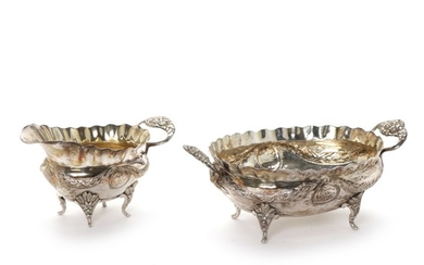 Danish silver Louis Seize oval sugar bowl and later creamer. 18th-19th century. Weight 595 gr. L. 17–23 cm. (2)