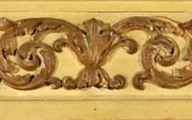 Element of carved woodwork, gilded and green rechampi decorated with angel heads and acanthus scrolls.