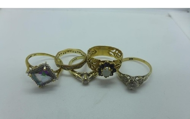 Five 9ct rings including a diamond solitaire, approx 0.10ct ...
