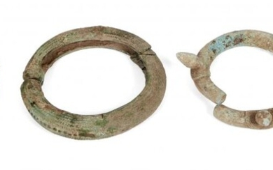 Five Chinese bronze bracelets, Neolithic period, one with chevron design,...