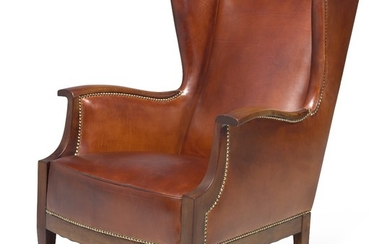 Frits Henningsen: Mahogany easy chair with curvy armrests. Sides, seat and back upholstered with cognac coloured leather, fitted with brass nails.