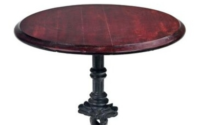 Pedestal table with cast iron tripod base with stylized dolphins....