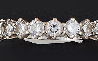 HALF - ALLIANCE in 18K (750 thousandths) white gold set with ten brilliant-cut diamonds. Total weight of the diamonds: about 1.20 ct. Finger size: 53. P. Rough: 3.4 g.