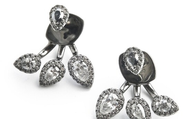 Hartmann's: A pair of diamond ear pendants each set with pear-shaped and brilliant-cut diamonds weighing a total of app. 1.19 ct., mounted in 18k white gold.