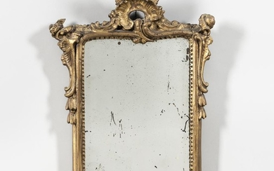 Louis XV Giltwood Mirror, France, 18th century, rectangular plate surmounted by stylized leaf and flower, scrolling side decoration wit