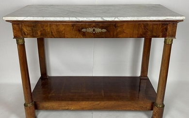 Mahogany and mahogany veneer console with detached columns. Bronze applications. One drawer in belt. Empire period. White marble top - 97 X 130 X 60 cm