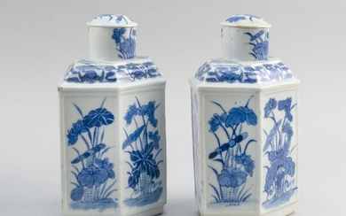 PAIR OF CHINESE BLUE AND WHITE PORCELAIN COVERED JARS In flattened hexagonal form, with bat and ruyi decoration at shoulder and lotu...