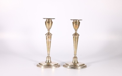 Pair of George V silver candlesticks raised on navette shape...