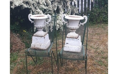 Pair of Victorian cast iron urns on pedestals {56 cm H}.