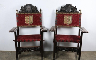 Pair of armchairs in molded and carved wood, brass and brass repoussé, velvet embroidered with wire coat of arms and copper applications.