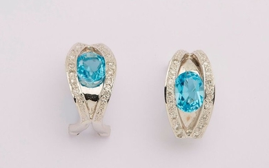 Pair of white gold earrings set with two...