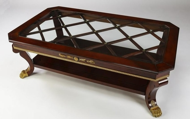 Parcel gilt and ebonized Regency style coffee table