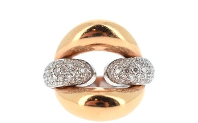 Ring in 18 K (750°/°°) yellow and white gold partially paved with brilliant-cut diamonds.