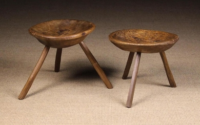 Two 19th Century Rustic Dish-topped Stools. The welled oval seats raised on three splayed chamfered