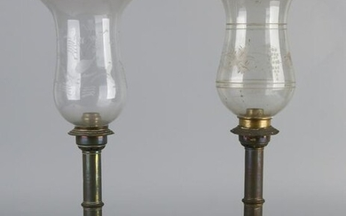 Two antique brass candle holders with etched glass