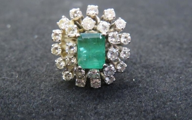 18 carat white gold emerald and diamond cluster ring,...