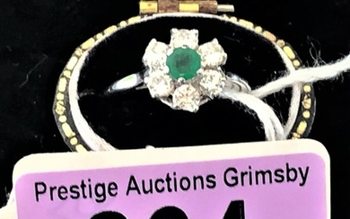 18ct white gold emerald and diamond ring size N This stunnin...