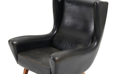 Illum Wikkelsø: Easy chair with rosewood legs, upholstered with black leather. Manufactured by Søren Willadsen.