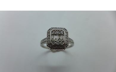 A 9ct white gold diamond octagonal cluster ring with four ba...