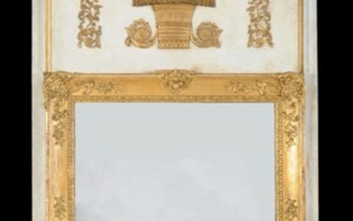 A Continental carved giltwood, composition and cream painted wall mirror