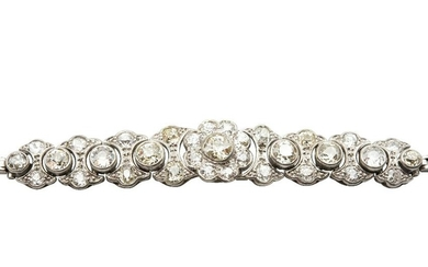 A DIAMOND BRACELET The central flora form cluster set