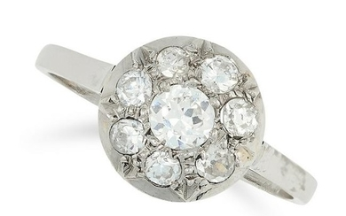 A DIAMOND CLUSTER RING set with a cluster of round