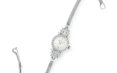 A DIAMOND COCKTAIL WATCH, MOVADO set with baguette and