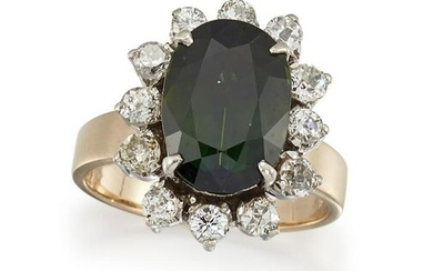 A GREEN SAPPHIRE AND DIAMOND CLUSTER RING The oval-cut